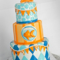 Goldfish Birthday Cake All marshmallow fondant. The design inspiration came from the client's birthday invitation. Loved making such a colorful cake!
