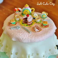 Spring Tea Party Cake  I made this mini tea party set for Payton's 4th birthday tea party. All of the pieces are gumpaste and were handpainted. I used an...