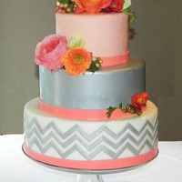 Coral & Silver Chevron Wedding Cake All marshmallow fondant with edible silver on the middle tier and chevron.