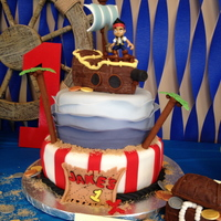 Jake And The Neverland Pirates Jake and neverland pirates first birthday cake! Ship and treasure chest made out of RKT, all other decorations made out of fondant.