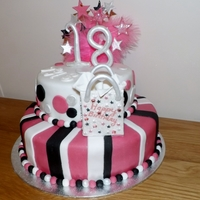 Tashas18Th Birthday Cake sponge/chocolate tiers with gumpaste accents.