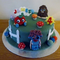 Moshi Monsters Cake chocolate sponge with chocolate joy icing,gumpaste monsters,differcult cake to make i had never heard of moshi monsters