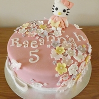 Hello Kitty chocolate sponge,covered in fondant,with gumpaste flowers and,hello kitty.