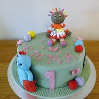 Emmas First Birthday Cake. sponge cake,with fondant upsy daisy,and iggle piggle.
