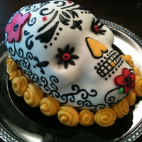 40Th Birthday Day Of The Dead Skull Wilton skull pan with MMF, sugar veil scrolling. This was for a 40th birthday Day of the Dead theme. Cake was creme brulee flavor.