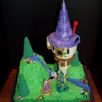 Kayton's Tangled Cake I made this for my granddaughter's 4th birthday. The bottom is a 3-layer 1/2 sheet chocolate cake covered in chocolate bc. The hills...
