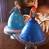 Elsa And Anna Birthday Cakes Elsa is a white cake, while Anna is a chocolate, both frosted in buttercream.