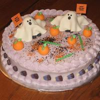 Halloween Birthday Butter cake with almond buttercream and fondant decorations.