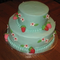 Strawberries And Blossoms Yellow cake with almond buttercream and gumpaste/fondant decorations. TFL