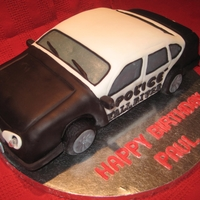 Police Car Cake My first car cake! Carved cake covered in modeling chocolate and fondant. Modeling chocolate tires. Real flashing headlights!