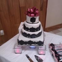Wedding Cake This is my wediing cake I did last year. Damask fondant decor and gumpast bow.
