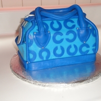 Coach Purse Cake   MMF purse cake. This was my first purse cake. Made it for a friend's pre-teen daughter who loved it!