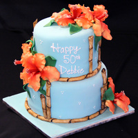 Hawaiian Birthday Cake Hawaiian themed birthday cake. All flowers and bamboo made from gumpaste and fondant. TFL!