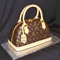 Louis Vuitton Purse  This cake was made for a birthday. The birthday girl actually ordered the cake for herself. LV logos handpainted using gold airbrush paint...