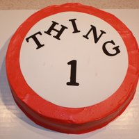 "Thing 1 Birthday Butter Pecan cake with whipped cream icing in red with a ""thing 1"" frosting sheet. TFL."