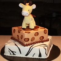 Giraffe Jungle Birthday Bottom cake is chocolate, top is white, both with a peanut butter icing filling. Coverd in buttercream icing, top has fondant accents and...