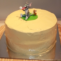 Tom And Jerry Birthday chocolate cake with whipped cream icing. Tom & Jerry is a plasic toy