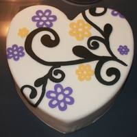 Flower Party-Practice Styrofoam hear shaped covered in fondant. the decorations are fondant also. TFL.