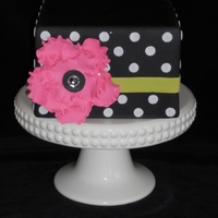 Black Dot Cake W/bling Black fondant cake w/dots and pink fantasy flower. Inspired by featured cake here on CC by jo3d33.