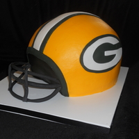 Go Pack Go Chocolate Cake With Chocolate Ganache Carved Into A Helmet With Gumpaste Face Mask GO PACK GO! Chocolate cake with chocolate ganache carved into a helmet with gumpaste face mask.