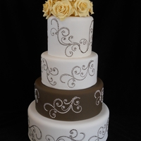 Brown Swirls And Yellow Roses Ivory cake w/brown layer and swirl pattern on each tier. Gumpaste yellow roses on top - design idea from dailey here on CC. LOVED her...