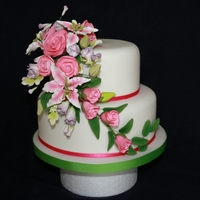 Spring Wedding   Quickest ever wedding cake! Purchased flower spray simply attached onto covered cakes.