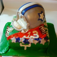 Nfl Dallas Cowboys Theme Party 2 layers of 8in sqaure cake and a top is the mini sports pan for helmet , with a 6 in cake under . All Mmf covered , buttercream accents...