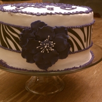 Zebra Cake My daughter's birthday cake. Red Velvet with cream cheese buttercream and raspberry filling. Wilton zebra sugar sheet. Purple fantasy...