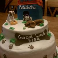 Good Luck yellow wasc cake, cream filling and french vanilla buttercream. Fondant/gumpaste dogs and accents. Pet hotel is made from rice krispy...