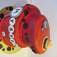 Mystery Csi Topsy Turvy Cake White and chocolate cakes covered in fondant that was hand painted with a dark brown over the red to give it a dark mystery look. All the...