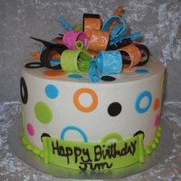 "8"" Round Cake   8"" buttercream with fondant accents."
