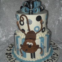 "Monkey Cake  6"" and 8"" tiered buttercream cake with fondant accents. My friend asked me add a monkey on the side because her husband likes..."