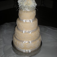 Ivory And Champagne Wedding Cake Fondant covered with royal icing lacework.