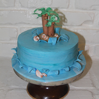 Beach Cake Buttercream with fondant accents and brown sugar sand.