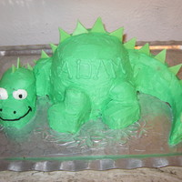 Dinosaur Cake Basic dinosaur cake covered in BC with fondant spikes.