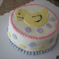 "Baby Ducky This is my first cake ever to decorate using more than ""slap on the icing"" techniques. It's a chocolate cake with a cream..."