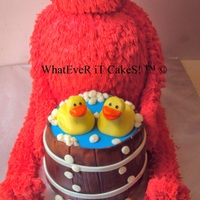 Elmo   body is cake, head rkt , arms fondant , barrell of duckies is cake with fondant accents TFL!!! this is my new fav cake!
