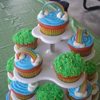 Rainbow Cupcakes Rainbow cake batter and gummy rainbow candy on top. bc icing