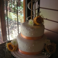 Peach And White Wedding my first time fully covering a cake in fondant. got dry and cracked...it was a learning experience and a free cake for my brother! they...