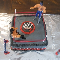 Wrestler Cake Cake iced in buttercream to look like wrestling ring.