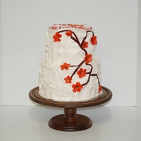 Rough Iced 2 Tier With Branches & Orange Flowers
