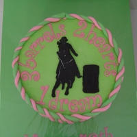 Pink & Green Barrel Racer 8 inch buttercream with fondant accents. White accent on silhouette done with white food coloring.