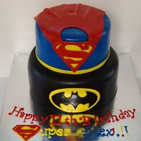Superman/batman Cake - 1St Icing Smiles Cake 10 & 8 inch with fondant covering & accents. Lettering with Funky Alphabet tappits. Superman and Batman logos were handcut.