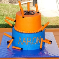 Nerf Cake With Bullets Bullets were made of fondant. Coffee stirrer was inserted in bullets which were to appear stuck to the cake.