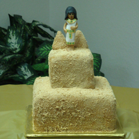 Cleopatra 12 and 8 inch square tiers covered in fondant and graham crackers crumbs. The fondant egyptian is made to match the birthday girls costume...