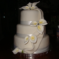 Cala Lillies 10,8, and 6 inch rounds covered in fondant with real ribbon