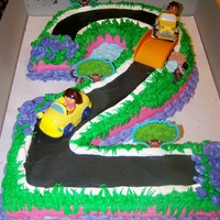 Dora And Diego Cake   Carved out of a full sheet cake. Frosted in buttercream and the toys were from a cake kit.