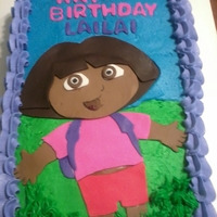 Dora The Explorer Cake   Frosted in BC with Fondant Dora Cut out.