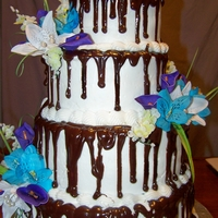 Chocolate Ganache Wedding Cake   Frosted in BC with a chocolate ganache drizzle. Silk Flowers.