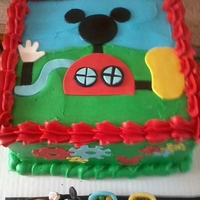 Mickey Mouse Club House Cake   Frosted in BC with fondant cutouts and Fondant train and Micky figure